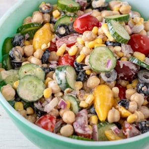 green bowl with colorful garbanzo bean salad