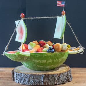 vegan fruit sald served in watermelon boat