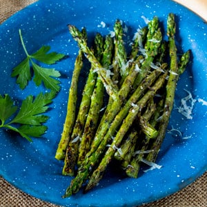 grilled asparagus on blue pewter plate