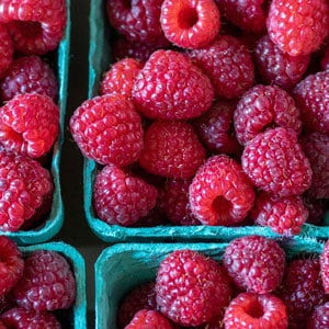 fresh raspberries in baskets