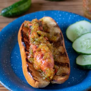grilled hot dog and bun topped with sweet pickle relish
