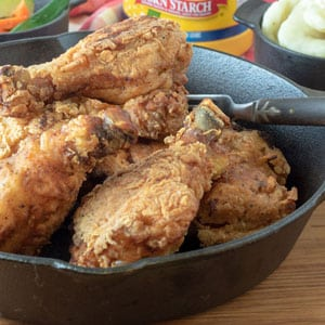 fried chicken in cast iron pan