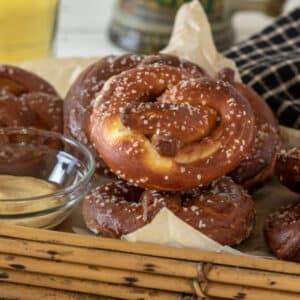 Stack of German pretzels in bamboo basket.