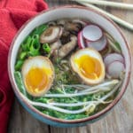 Chicken ramen in bowl with ramen egg and colorful veges.
