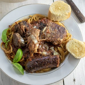 meaty pasta on white plate