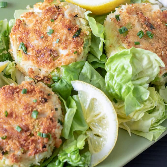 carb cakes on bed of lettuce with lemons
