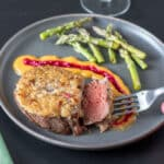 horseradish crusted beef filet on gray plate