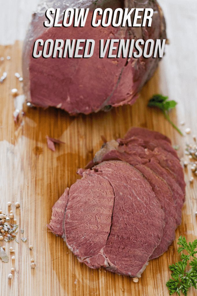 Slow cooker corned venison Pinterest image with text overlay.