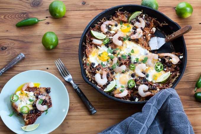single serving baked chilaquiles with broken egg yolk