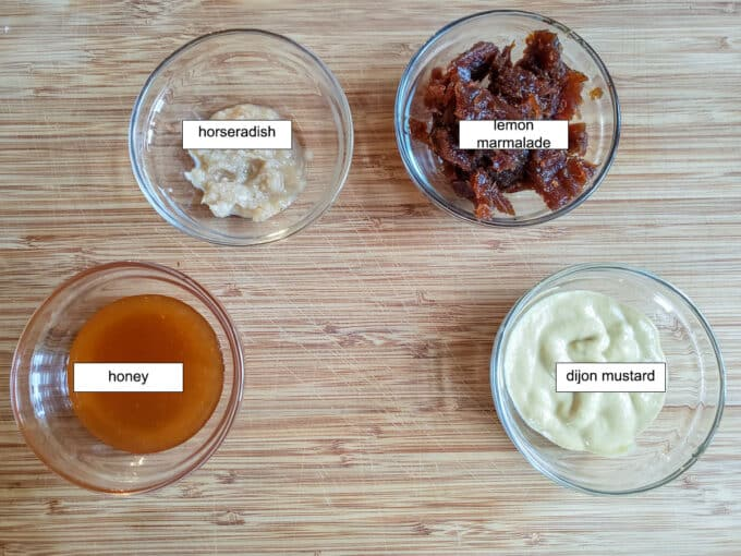 Ingredients for sauce. horseradish, lemon marmalade, dijon mustard, honey.