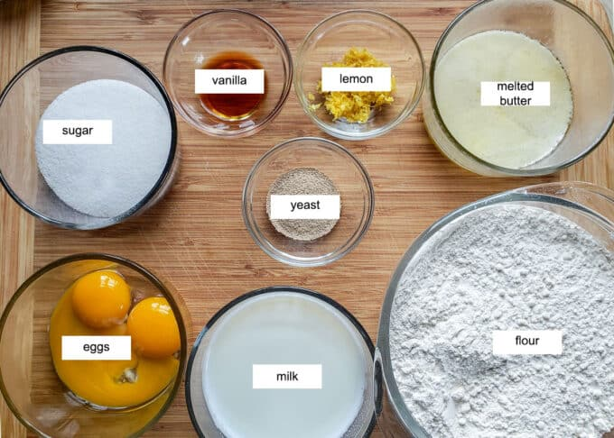 Ingredients for yeast dough sugar, vanilla, lemon, butter, yeast, eggs, milk, flour.