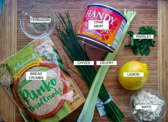 Ingredients for crab cakes panko, tarragon, crab, chives, celery, parsley, lemon, mayo