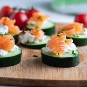 Cucumber appetizers with homemade lox and cream cheese.