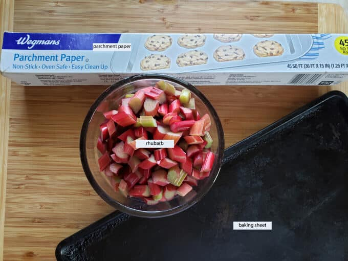 Equipment needed for freezing rhubarb; parchment, rhubarb, baking sheet.