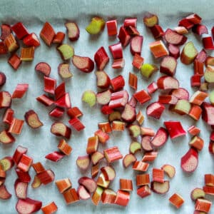 Chopped rhubarb on parchment paper.