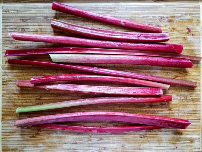 Rhubarb leaf stalks (petioles) on cutting board.