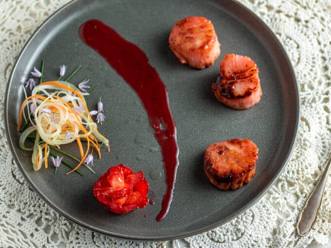Scallops with strawberry sauce and micro salad.