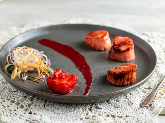Plate with scallops and strawberry flower.