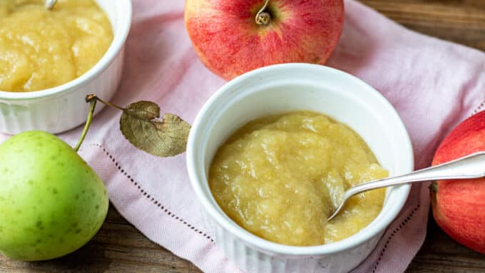 Close up of white bowl with applesauce.