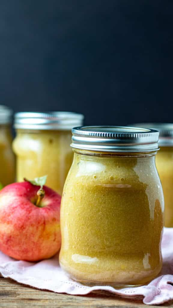 Close up of jars of applesauce.