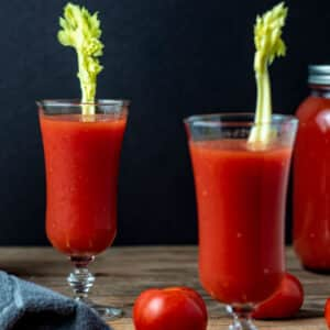 Glasses of tomato juice with celery.