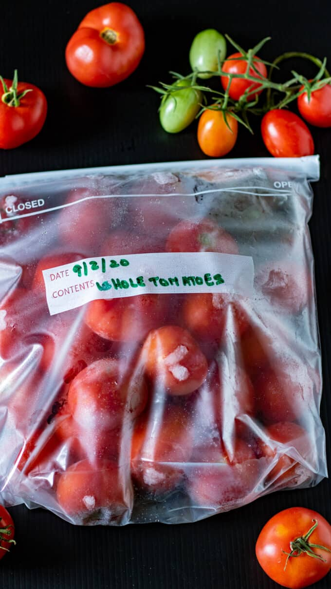 Whole red tomatoes in gallon freezer bags.