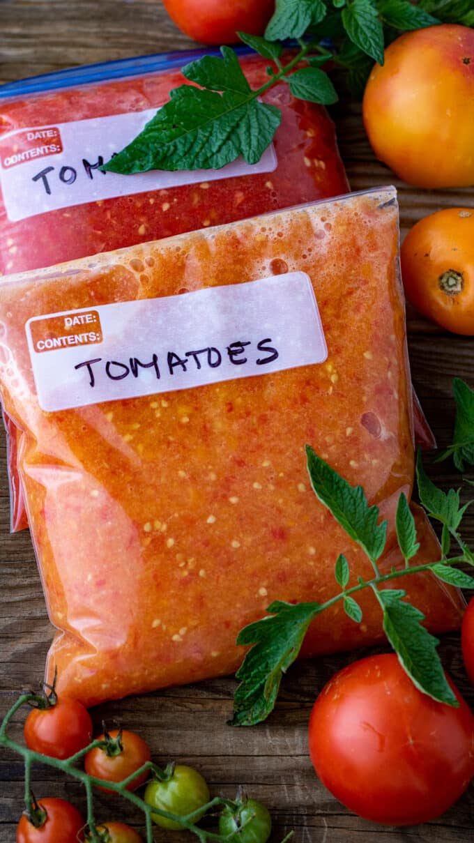 Crushed tomatoes in freezer bags.
