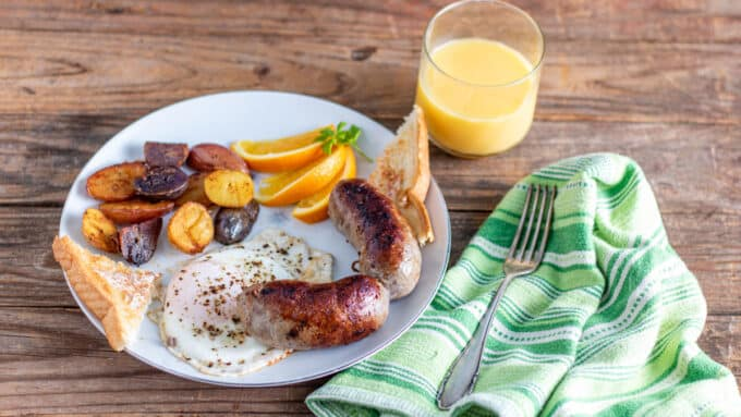 Links of sausage cooked with breakfast foods.