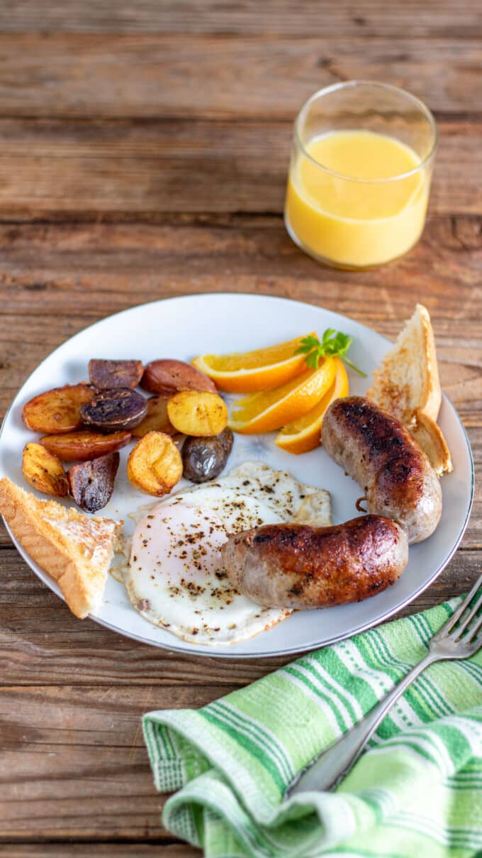 Large breakfast plate with sausage links.