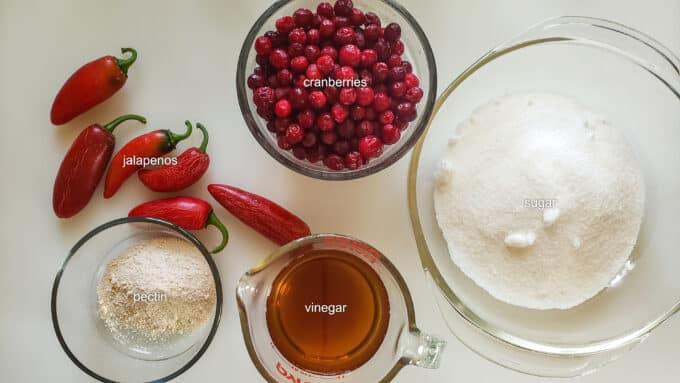 Ingredients needed for recipe; cranberries, jalapenos, sugar, pectin, vinegar.