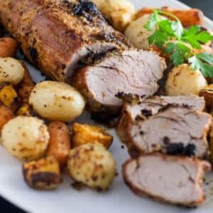 Sliced pork with roasted vegetables.