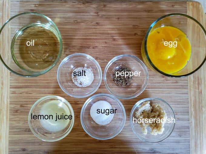 Ingredients for sauce egg, oil, salt, pepper, lemon juice, sugar, horseradish.