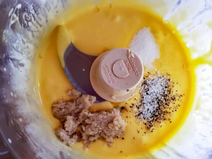 Aioli in food processor with additional ingredients added.