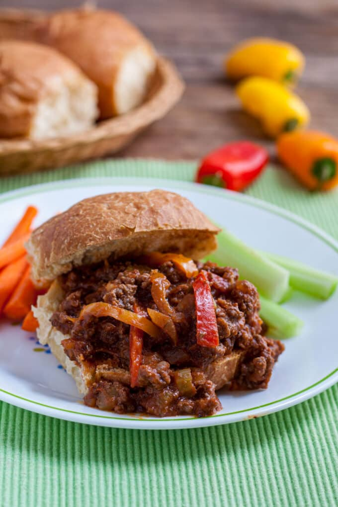 Close up of sandwich piled high with meat and peppers.