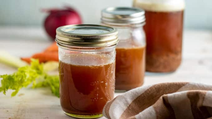 Strained venison stock in jars.