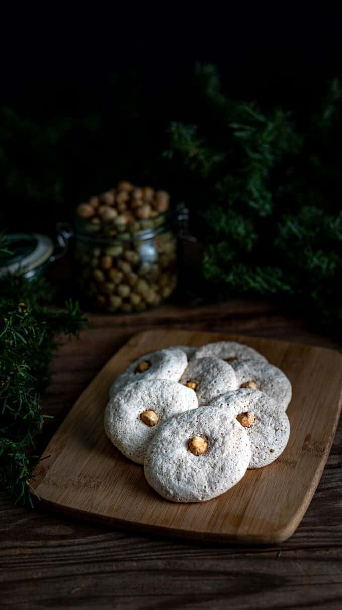 Dark and moody photo with highlighted cookies in center.