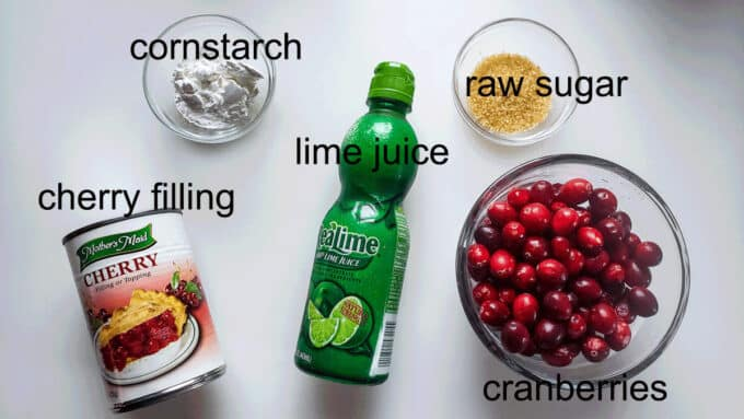 Ingredients for filling cherry pie filling, cornstarch, lime juice, raw sugar, cranberries.