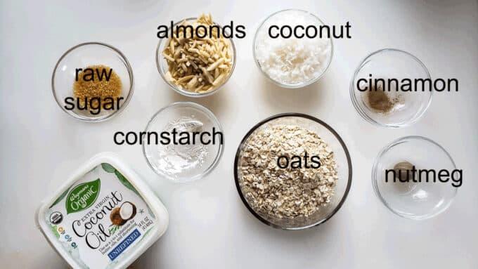 Ingredients for topping; coconut oil, sugar, cornstarch, almonds, coconut, cinnamon, nutmeg, oats.