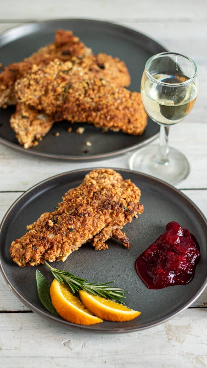 Crispy crusted turkey on grey plate with sides.