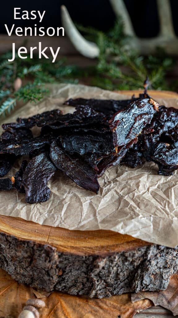 Venison jerky Pinterest image with text overlay.