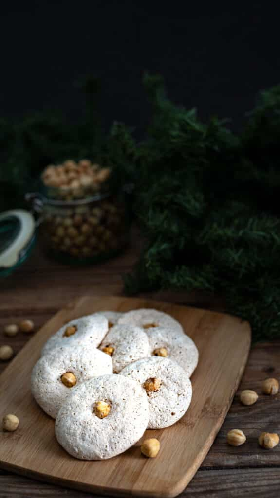 Pile of cookies on wooden board.