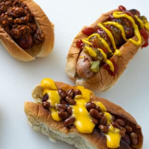 Air fried hot dogs with different toppings.