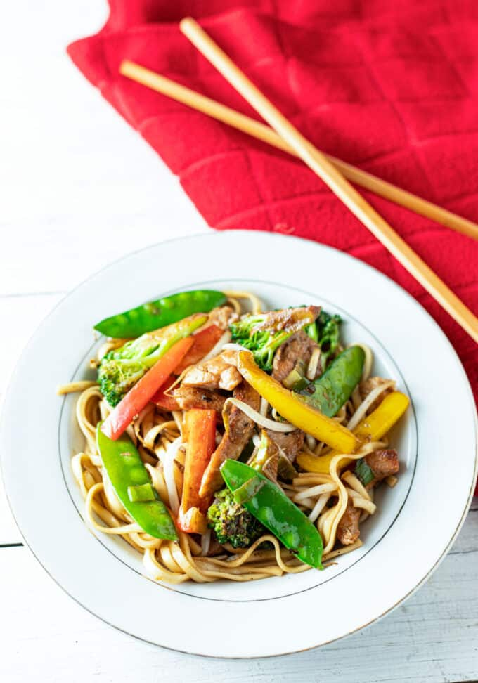 Large bowl of colorful chicken lo mein.