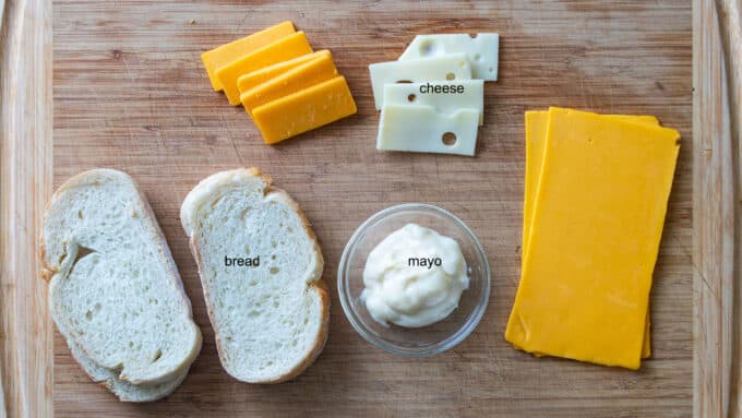 Ingredients for grilled cheese; bread, cheese, mayonnaise.