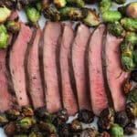 Sliced deer heart with brussels sprouts.