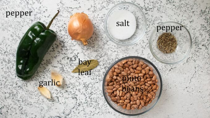 Ingredients for beans. Pinto beans, garlic, bay leaf, pepper, onion, salt, pepper.