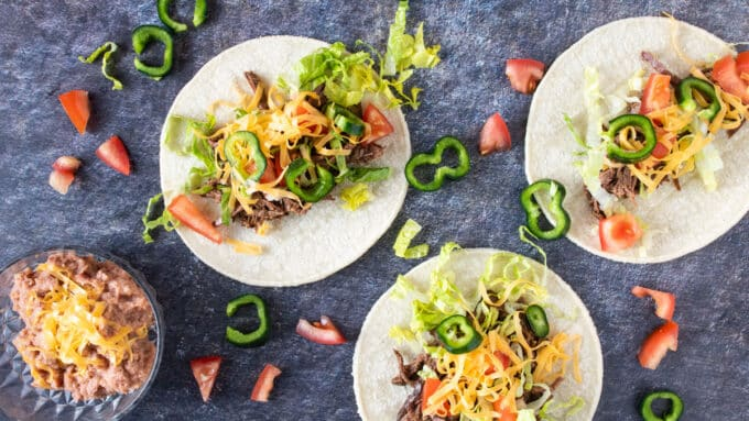 Overhead photo of tacos and refried beans.