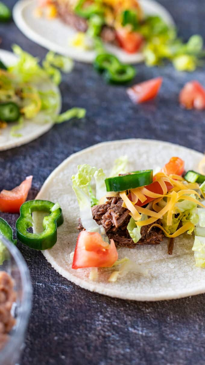 Close up of venison on tacos.