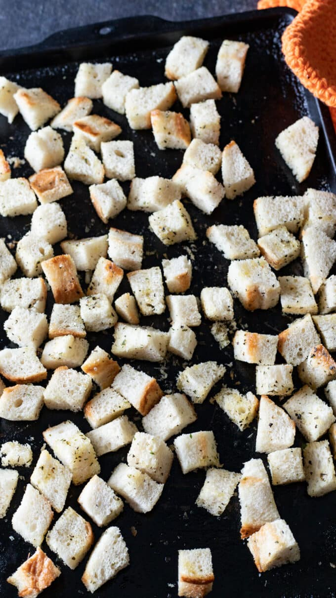 Baked croutons on antique baking sheet.