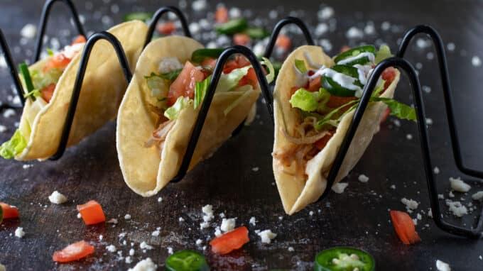 Three tacos in taco holder.